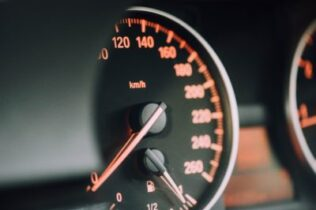 Speedometer on dash of car