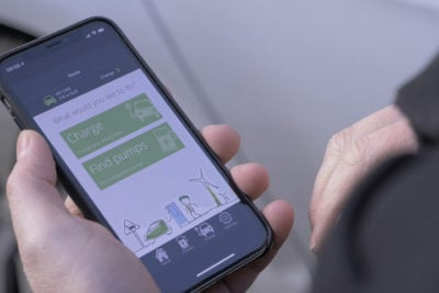 Person holding phone with Ecotricity utilities app open.