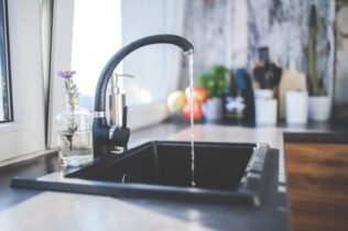 Water flowing from tap to the sink.