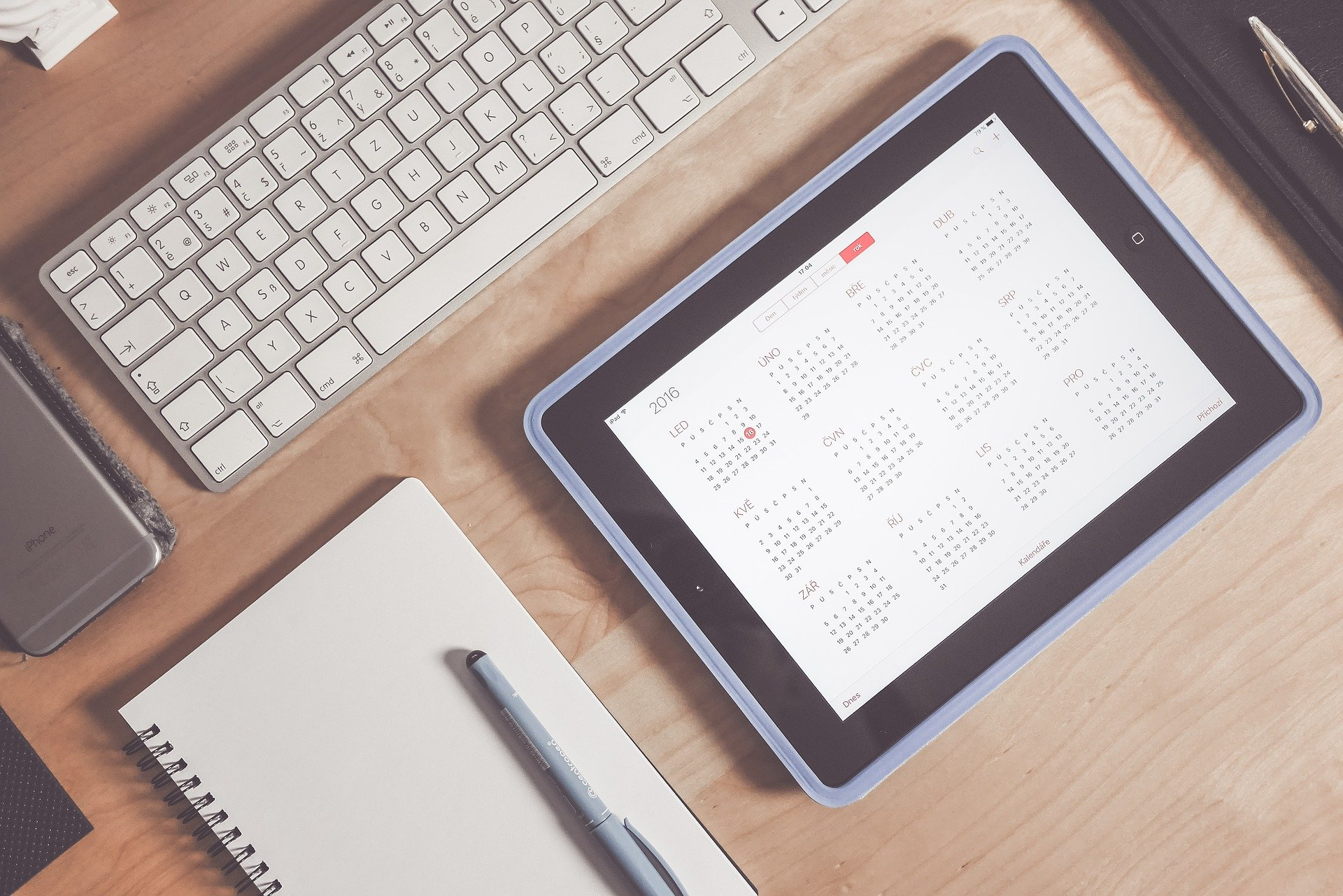Tablet open to year-long calendar, sitting on desk