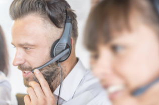 man and woman on headsets