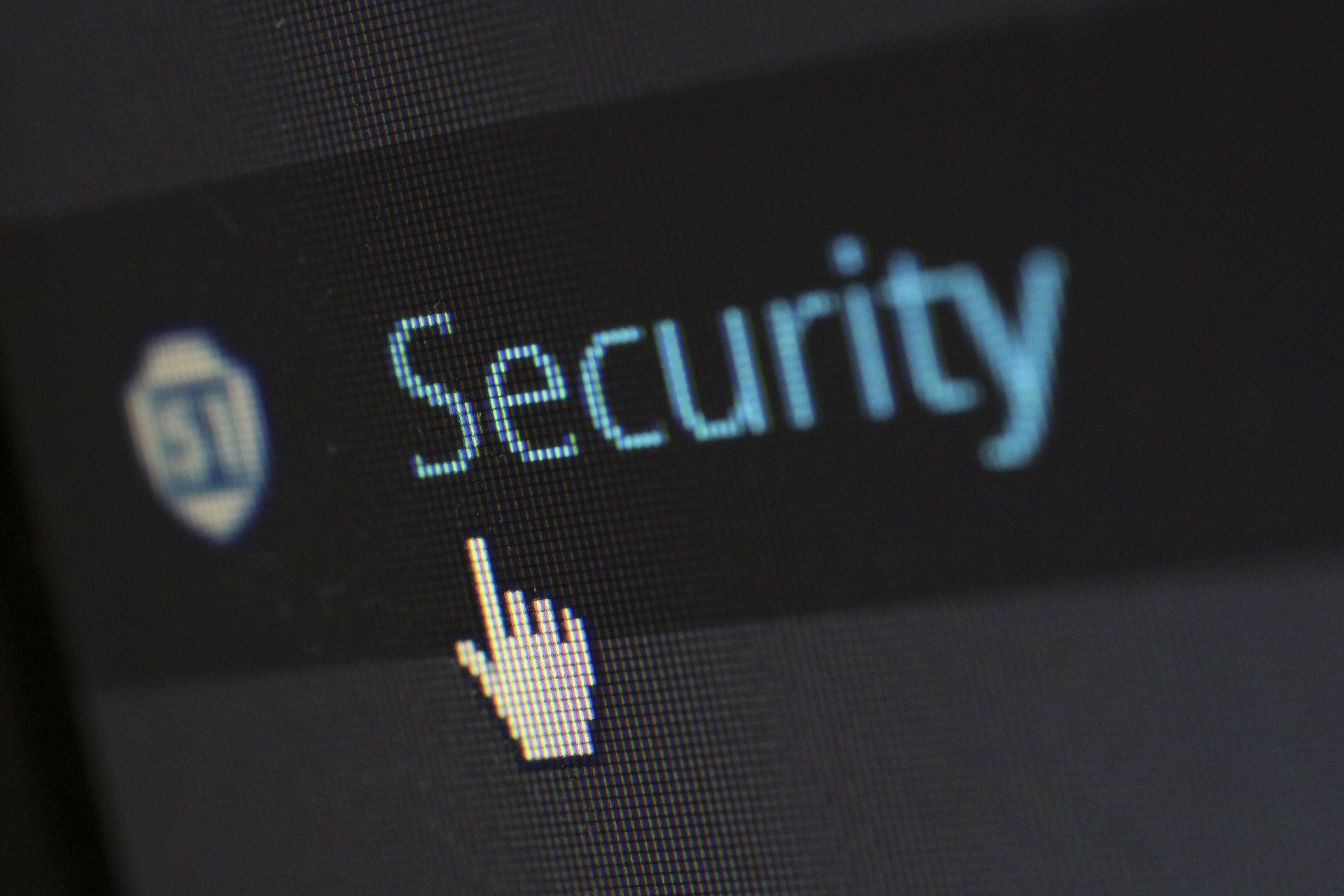 """The word """"Security"""" is on a computer screen, with the mouse pointing up to it"""