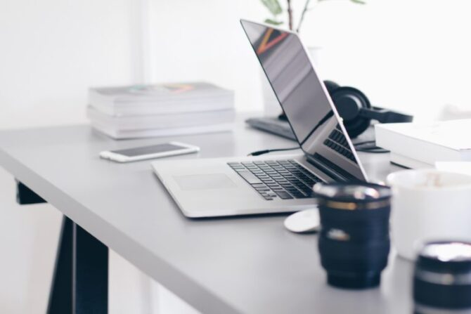 Computer half open on a desk