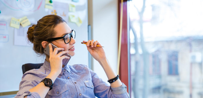 Woman on phone making IVR payment
