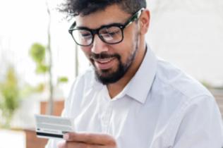 Man viewing credit card