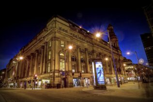 Royal Exchange Theatre Manchester at night telephone based payments