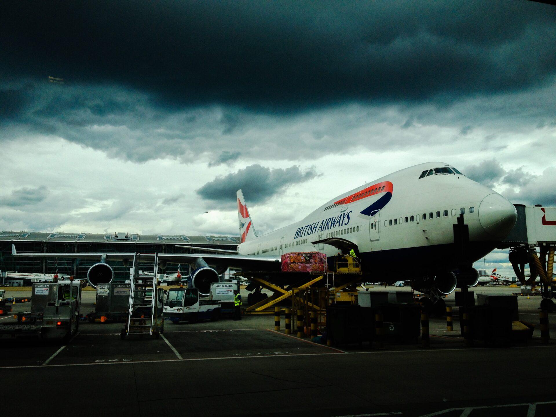 British Airways Data Breach; plane parked under dark and stormy sky.