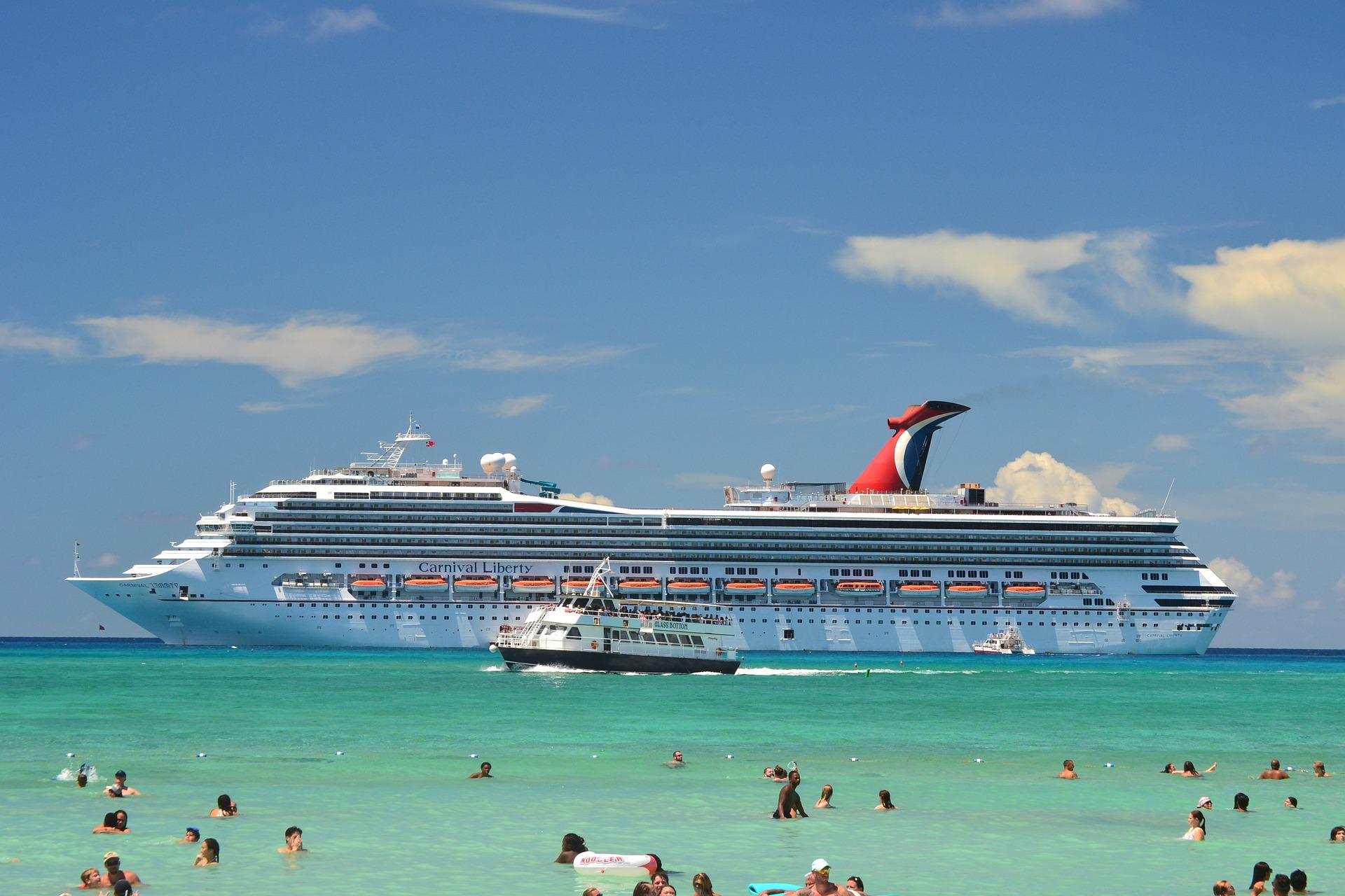 Carnival Cruise Ship out at sea, near the shore.