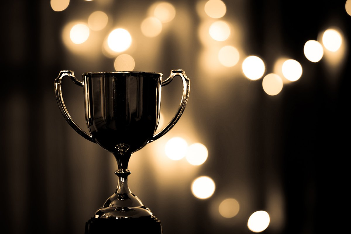 Award trophy and fairy light background